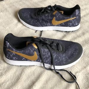 Navy and gold Nike sneakers